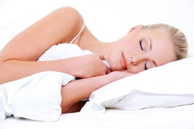 Beautiful pretty sleeping woman cover the white blanket